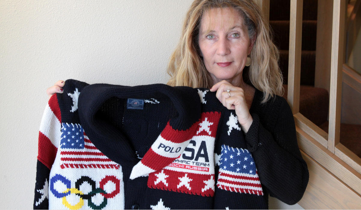 File photo. Imperial Stock Ranch owner Jeanne Carver holds up Team USA's Opening Ceremony sweater from the 2014 Sochi Olympics. CREDIT DAVID NOGUERAS / OPB