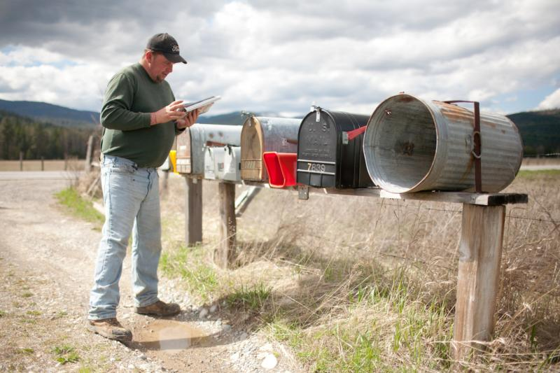 Shaun Patrick Winkler gets his mail, approximately 2 miles away from his property near Priest River, Idaho. He explained that since he started running for office, he gets more solicitations and junk mail.