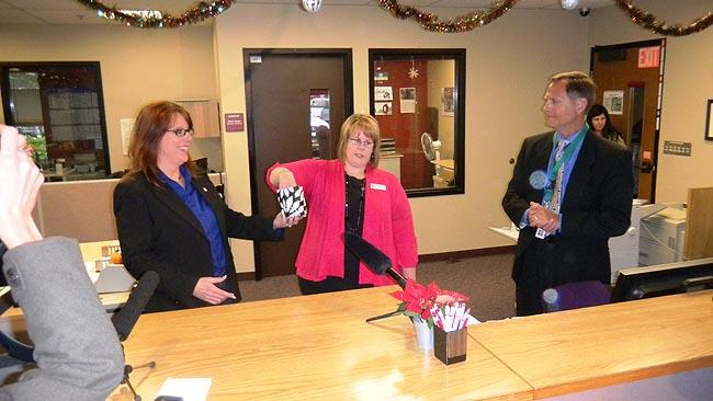 Thurston County Auditor Kim Wyman, left, holds a drawing for the first 10 same-sex couples to receive marriage licenses.