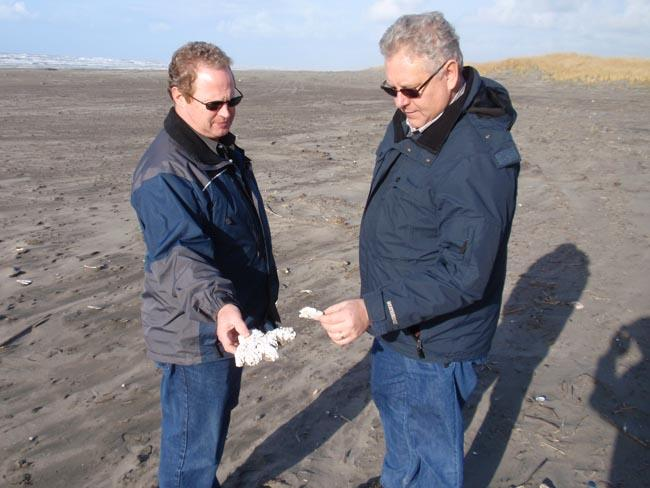 Chuck Matthews (left) and Curt Hart of WA Dept. of Ecology consult about flotsam that -- like most found on Long Beach – is impossible to trace to a specific origin.