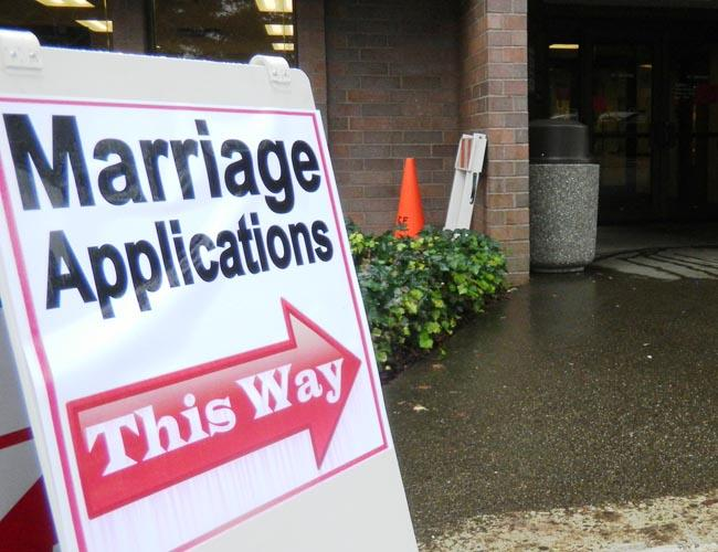 Signs at the Thurston County Courthouse directed couples
