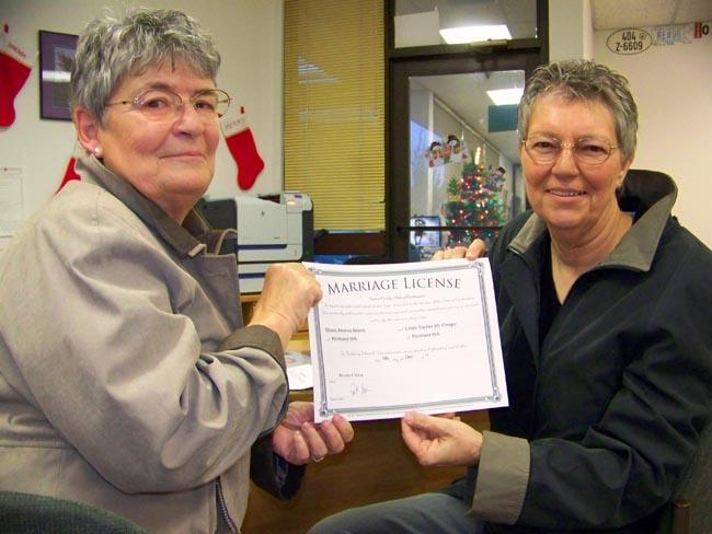 Linda McGregor, left, and Diane Marsh, have been together for 26 years. They shed tears on Thursday when they were able to pick up their Washington State marriage license.