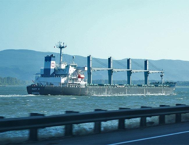 Liberia flagged grain ship Mary H. heads out to sea on the Columbia River.