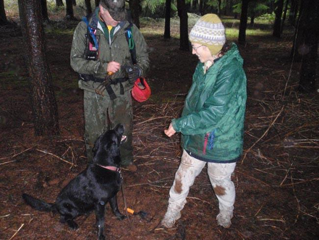 "Mia MacCollin of Bend (right) celebrates the first truffle find of her dog ""Boston"" at a Willamette Valley tree farm."