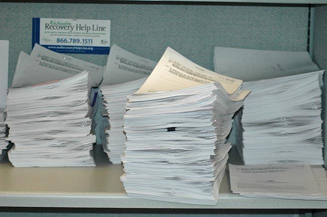 Mental health background checks for people looking to buy a gun. Each piece of paper can contain between one and 50 names sent by a police agency.
