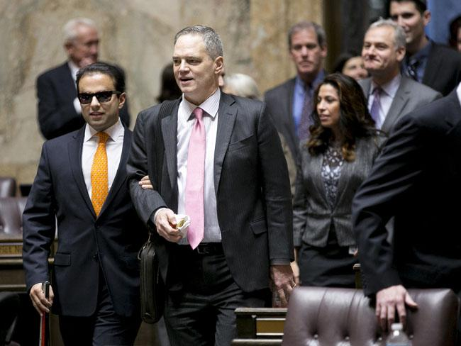 Rep. Cyrus Habib (far left) enters the state House chamber in Jan. 2013 on the arm of Rep. Ross Hunter for his swearing in.