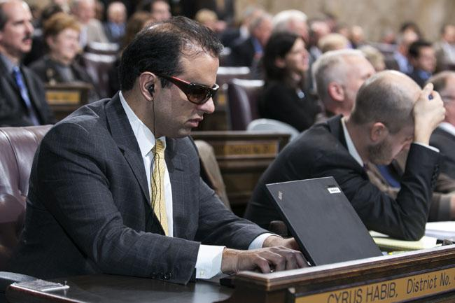 Rep. Cyrus Habib listens as his laptop reads his incoming email to him via text-to-speech conversion software.