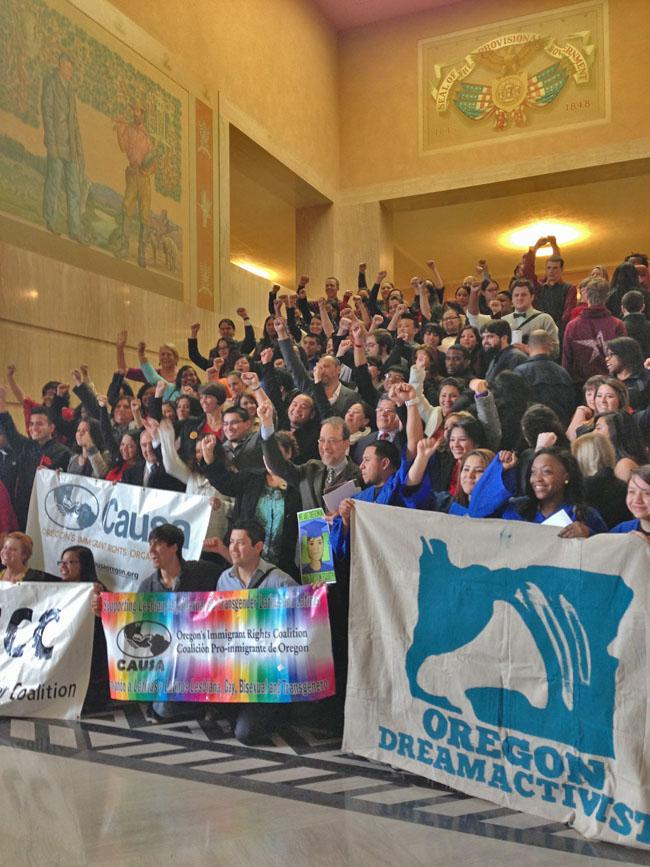 A group cheers the Oregon Senate's approval of a bill that would grant in-state tuition to the children of illegal immigrants.