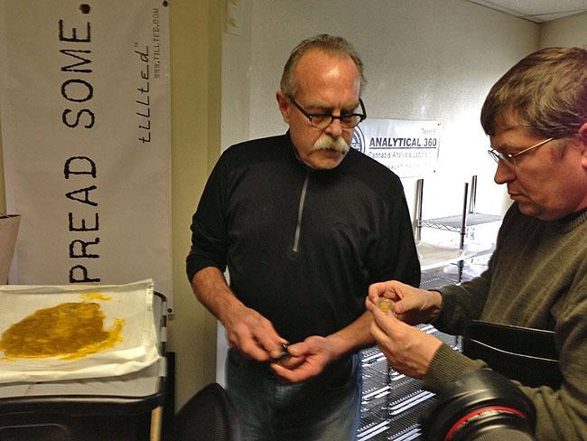 Marijuana extractor Jim Andersen of XTracted shows Mike Steenhout of the Liquor Control Board a sample of high THC hash.
