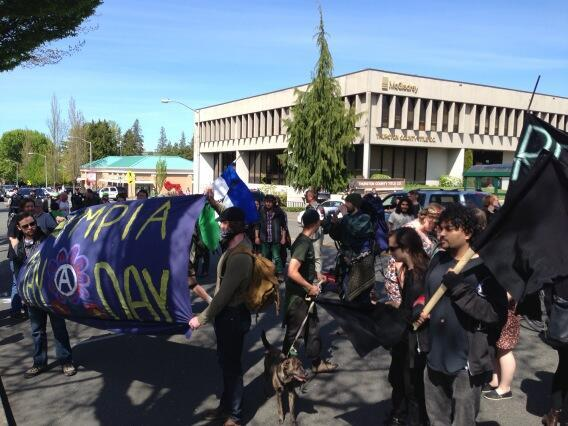About 60 protesters took part in Wedesday's May Day march in Olympia.