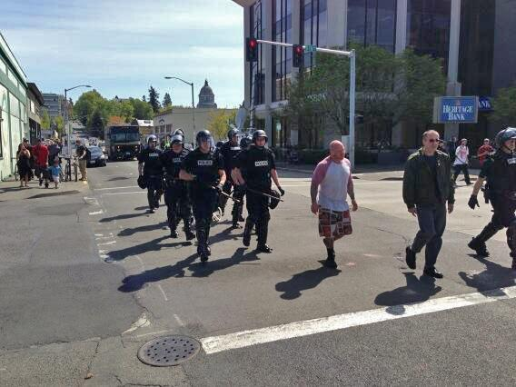 Police in riot gear took up the rear of the march.