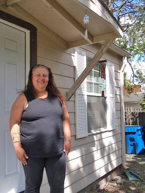 Deborah Favors stands in front of her apartment in Stayton, Oregon.