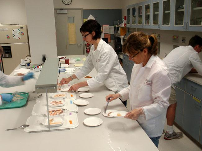 Researchers at the WSU School of Food Science prepare trout samples