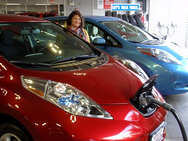 Miranda Lewis of Duvall, WA picks up her brand new Nissan Leaf.