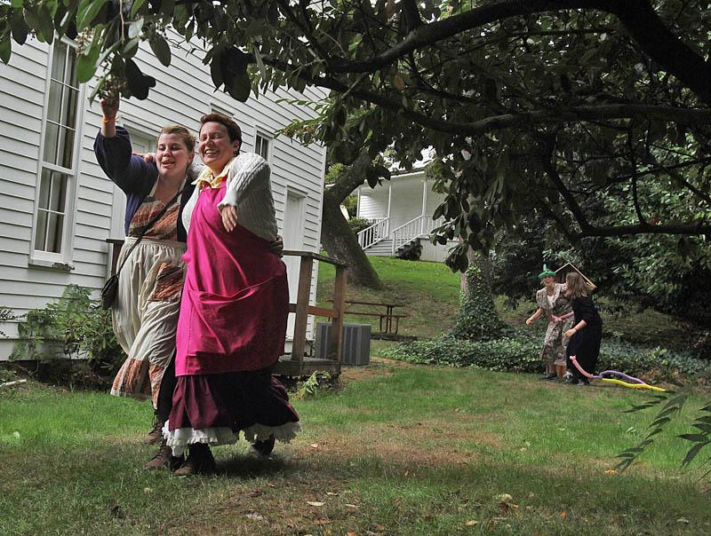 Alex Hagiepetros, of Portland, left, and Emma Buktenica, of Monmouth, compete in a Dysentery Three-Legged race in The Oregon Trail LIve II at the Willamette Heritage Center.