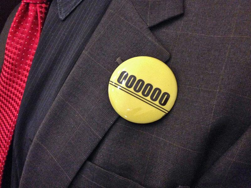 Members of the Washington Education Association wore these buttons to Governor Jay Inslee's supplemental budget rollout to signify five years without voter-approved cost-of-living increases.