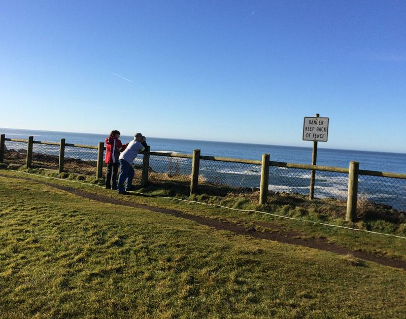 Larry and Marie Hinton keep an eye out for whales at Boiler Bay State Park near Depoe Bay, Oregon.