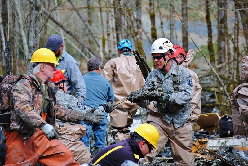 Rescue workers are combing the site of a massive landslide near Oso, Wash.