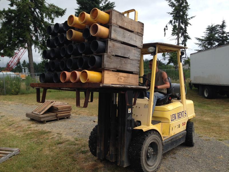 Empty fireworks mortars are loaded onto a truck at Entertainment Fireworks