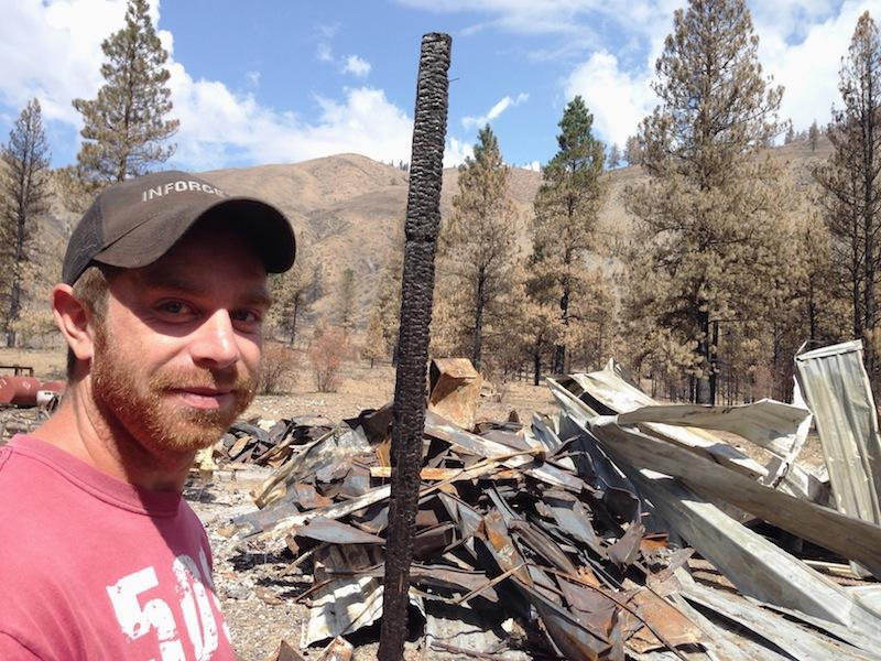 Kent Stokes, 28, of Twisp, Washington, surveys the ruins of his large shop and home. He estimates his family lost about 20,000 acres of grazing land in the fires this year.