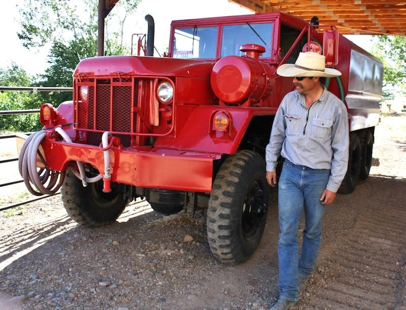 A water tender for fighting wildfires is parked next to rancher Charlie Lyon's barn near Mountain Home, Idaho.