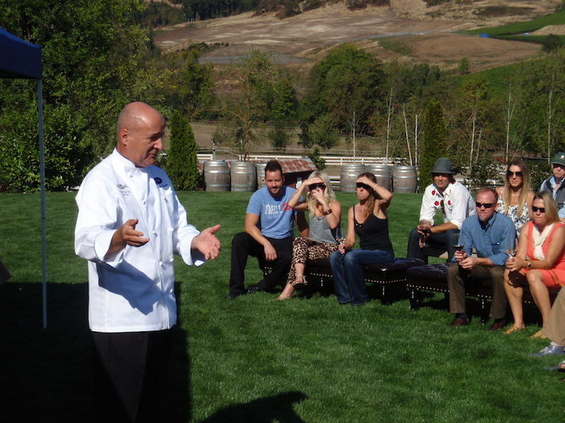 Chef Philippe Parola speaks to attendees at Sunday's Eradication by Mastication dinner at Zenith Vineyard.