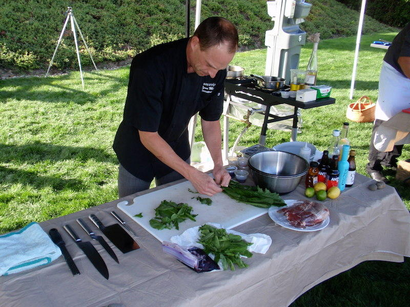 Chef Ryan Morgan of Portland competes in the invasive species cook-off on Sunday.
