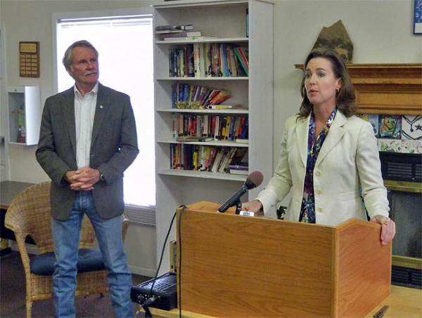 John Kitzhaber, left, looks upon Cylvia Hayes in this file photo.