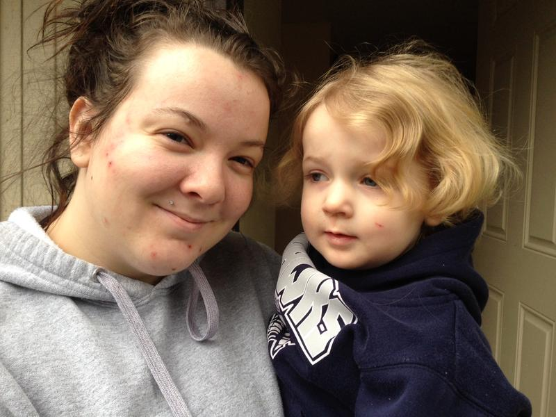 Former foster runaway Amber Armstrong holds her daughter Janessa, age 2