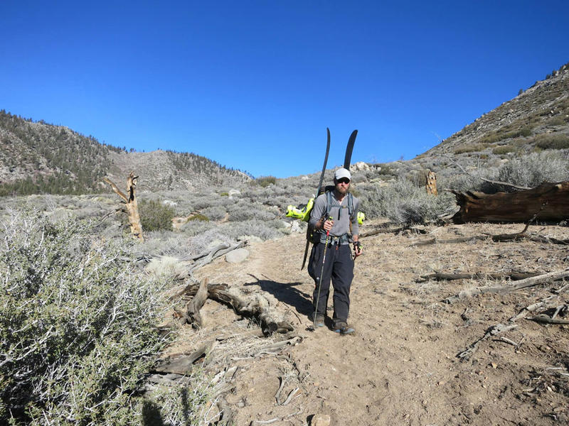 Forry not looking happy about carrying skis as the trail transitions to desert in Southern California.