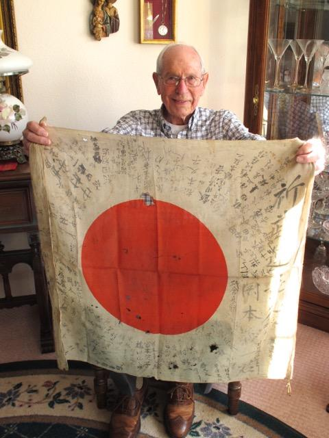 U.S. Army veteran Buck Weatherill shows off the good luck flag that he brought home from WWII.