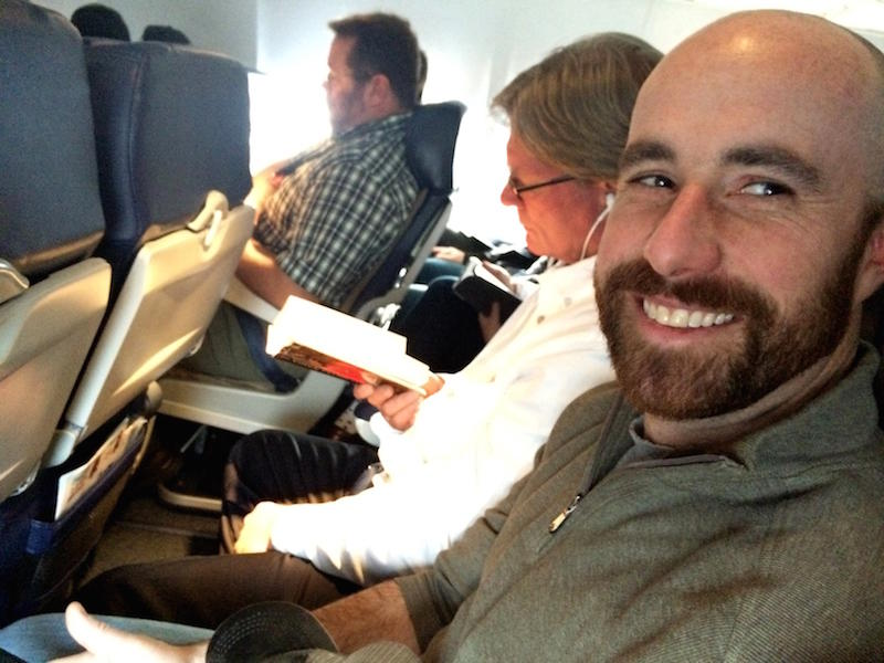 Republican Rep. Luke Malek of Coeur d'Alene gets stuck in a middle seat next to a reporter.