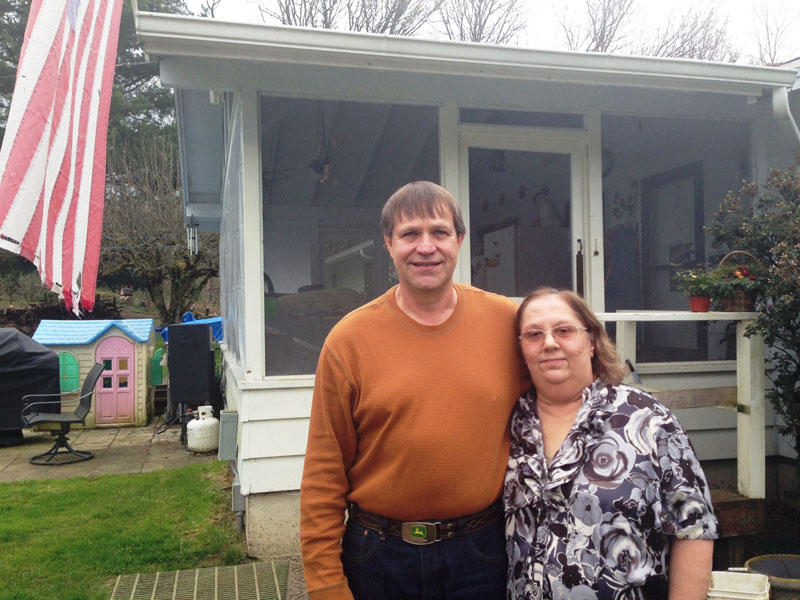 Dwight Hauck and his wife and Susie pose outside their home in Auburn, Washington. Dwight was the lone survivor in a crew shuttle that was hit by a fast-moving freight train at a rail yard in 2011.