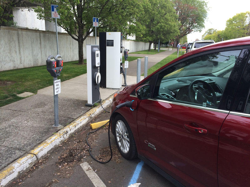 An electric vehicle is charging up outside of the Oregon capitol.