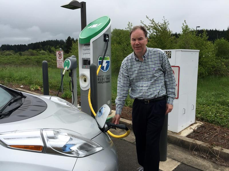 Tom Banse recharges at a West Coast Electric Highway station at the Grand Ronde tribal casino.