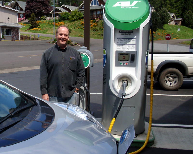Winegrower Terry Brandborg stands beside the public charging station he hosts at Brandborg Winery in Elkton, Oregon.