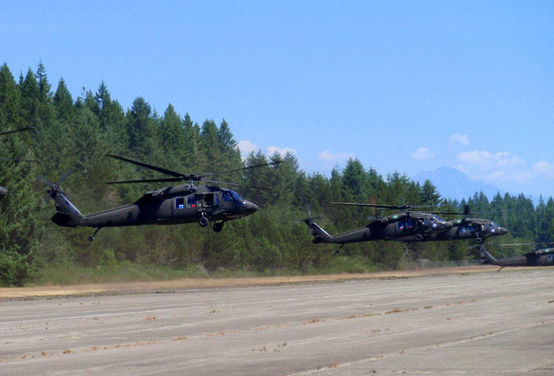 Washington National Guard Blackhawk helicopters land at the Shelton, Washington airport during the Evergreen Tremor earthquake response exercise.