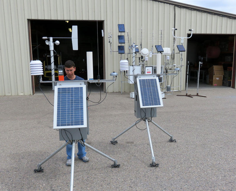 Technician Justin Dopp checks high-tech, portable weather stations before they are packed up for the next incident.