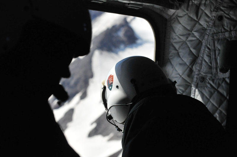 National Park Service rangers search for a missing climber from above the glaciers of Mt. Rainier National Park this past June.