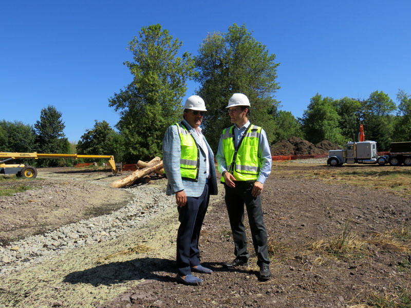 Aegis Living CEO Dwayne Clark, left, and development manager Brian Palmore at the future location of the Chinese-themed retirement home Aegis Gardens in Newcastle, Washington.