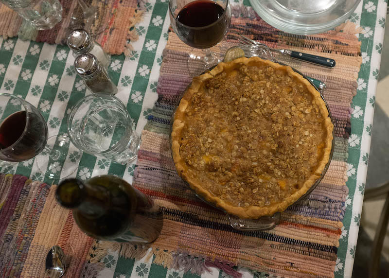 Friends gather at a kitchen table at the Methow Valley Inn to drink, eat and smother worry over fires and smoke with nectarine pie.