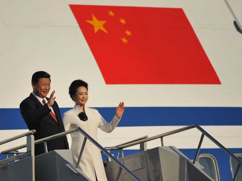FIle photo. President of China Xi Jinping and his wife Peng Liyuan arrive at the 2013 APEC summit in Indonesia. President Xi will visit the Seattle area on Tuesday and Wednesday.