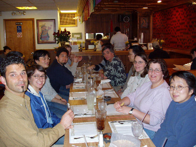 Frannie Smith at lunch with her Ph.D. research advisors and group mates at the University of Michigan in 2003.