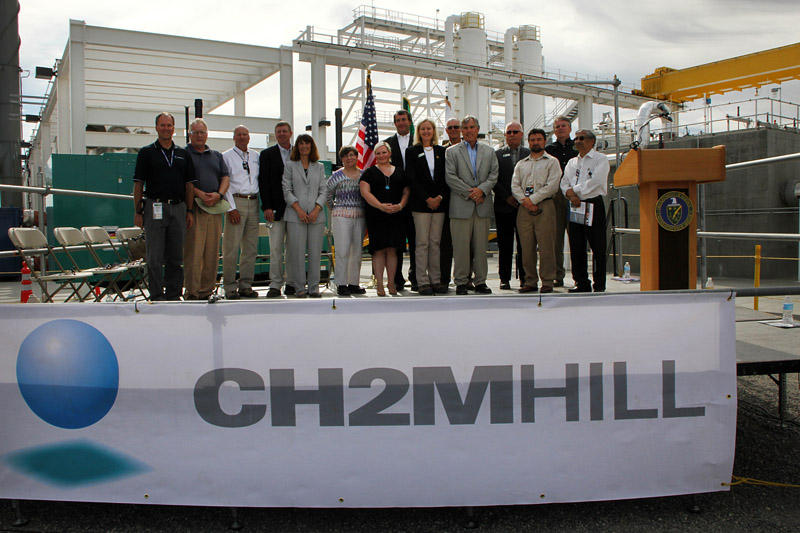 Jane Hedges, fifth from left, attends the grand opening of the Hanford 200 West groundwater treatment facility in August 2012 with colleagues from the U.S. Department of Energy and federal contractors.