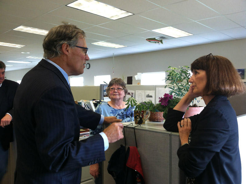 Governor Jay Inslee stops by Ecology's Richland office in 2013 to visit with Jane Hedges and other staff members.