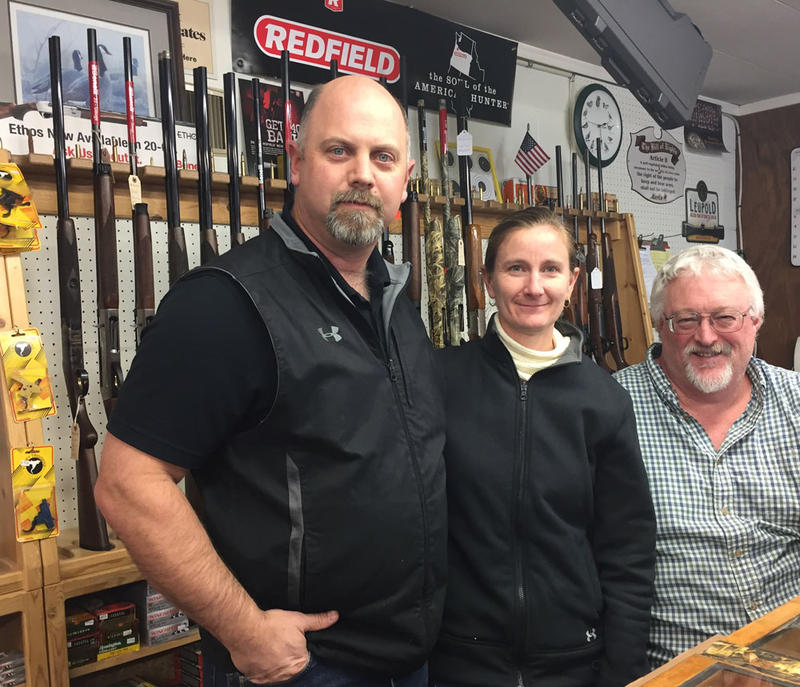 Denny Thomas and his wife Frances own B&B Sporting Goods. Chuck Steeves, on the far right, works the store too. They say business in guns and ammo really hasn't been much more busy than usual since the Malheur occupation began.