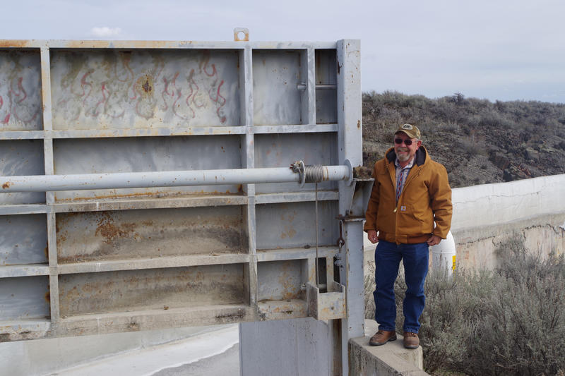 Lynn Harmon, manager of the American Falls Reservoir District #2, stands next to a diversion gate on the Milner-Gooding Canal. This will be used starting next winter to direct water into a large new recharge basin near Shoshone, Idaho.