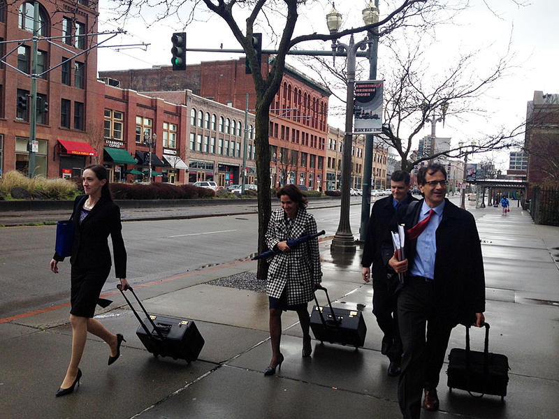 Washington State Auditor Troy Kelley, third from left, leaves the federal courthouse in Tacoma after the first day of jury selection in his trial on charges of money laundering and tax evasion.