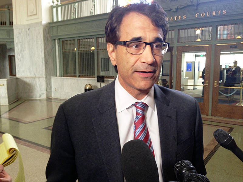 Defense attorney Angelo Calfo speaks to reporters after a jury found his client, State Auditor Troy Kelley, not guilty on one count of lying to the IRS and deadlocked on all remaining counts in his real estate services and tax fraud case.