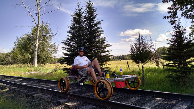 Joseph Branch Railriders co-owner Kim Metlen demonstrates pedaling a Railrider.